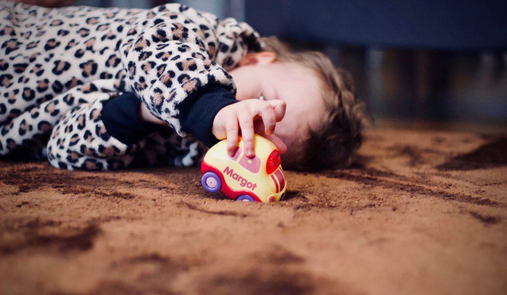 Child lying on carpet